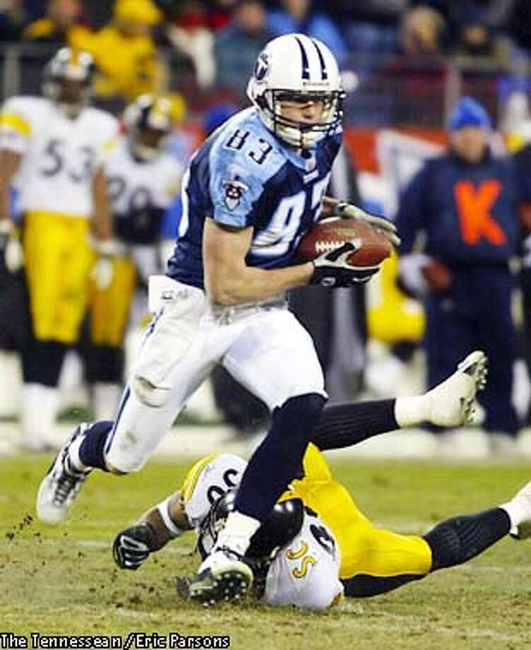 1/11/03-c-titansVsteelersep4F---Titans wide receiver Drew Bennett evaded Steelers cornerback Chad Scott after a reception for a 20-yard gain during the fourth quarter Saturday at the Coliseum. Staff photo by Eric Parsons (The Tennessean / Eric Parsons) Photo: Eric Parsons