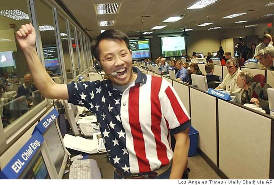 Entry Descent and Landing Chief Engineer Wayne Lee recacts in the control room at NASA's Jet Propulsion Laboratory as the get a signal for the Spirit after it landed, Saturday, Jan. 3, 2004, in Pasadena, Calif. (AP Photo/pool/Los Angeles Times, Wally Skalij) Photo: WALLY SKALIJ