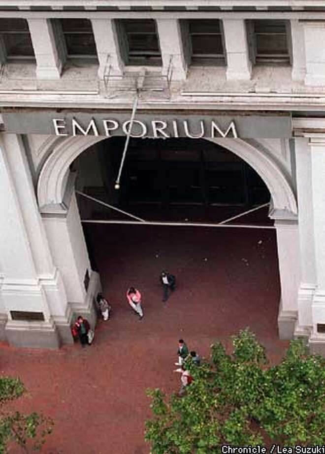 BROADWAY/C/04AUG95/BU/LS  SHOPPERS AND PEDESTRIANS FILE PAST THE MAIN ENTRANCE OF EMPORIUM ON MARKET STREET IN SAN FRANCISCO. FEDERATED DEPARTMENT STORES DISCLOSED AUG 15, 1995 THAT IT PLANS TO PHASE OUT THE EMPORIUM AND WEINSTOCKS NAMES ENTIRELY AS PART OF ITS ACQUISITION OF LOS ANGELES-BASED BROADWAY STORES INC. ALSO RAN: 12/28/95, 06/11/98, PHOTO BY LEA SUZUKI / THE CHRONICLE. Photo: LEA SUZUKI