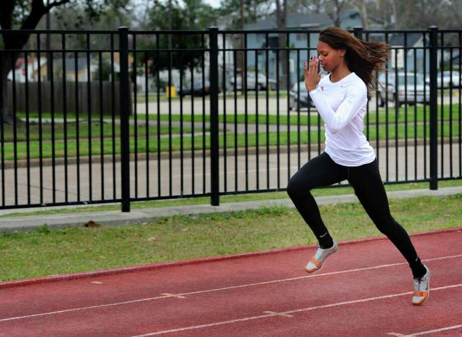 """A Cardinal competitor in the triple jump, high jump and long jump, Erin Brown was featured on the E! network's """"Scouted"""" Monday night. The track athlete said she has previously modeled in large market areas and will go to New York this summer to work as a model. Brown practices warms up before practice at Lamar on Thursday. Photo taken Thursday, January 19, 2012 Guiseppe Barranco/The Enterprise Photo: Guiseppe Barranco, STAFF PHOTOGRAPHER / The Beaumont Enterprise"""