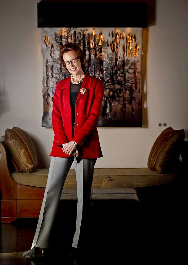 Taste Catering founder Meme Pederson is seen on Monday, Jan. 16, 2012 in San Francisco, Calif., in front of Jonah Ward's Burning Water No. 4, 2011, 48 x 48, Mixed Media at 12 Gallagher Lane. Photo: Russell Yip, The Chronicle
