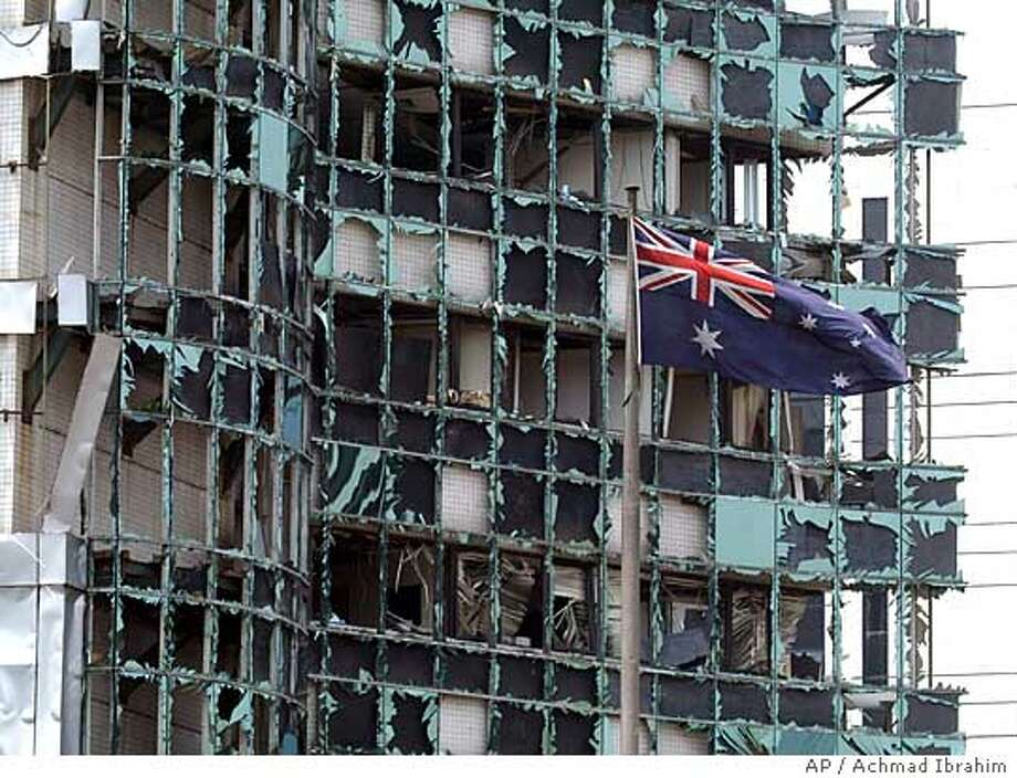 An Australian flag flies near a damaged building, following a blast outside the Australian Embassy, Thursday, Sept. 9, 2004, in Jakarta, Indonesia. At least three people were killed and more than 50 were wounded. (AP Photo/Achmad Ibrahim) Ran on: 09-09-2004  An Australian flag flies near a damaged building in Jakarta, Indonesia, after an explosion outside the Australian Embassy. Ran on: 09-09-2004  An Australian flag still flies outside a damaged building in Jakarta, Indonesia, after an explosion near the Australian Embassy. EDS NOTE: BUILDING SHOWN IS NOT THE AUSTRALIAN EMBASSY Ran on: 10-24-2004  An Australian flag flies near a damaged building following a bomb blast outside the Australian Embassy on Sept. 9 in Jakarta, Indonesia. Ran on: 10-24-2004 Photo: ACHMAD IBRAHIM