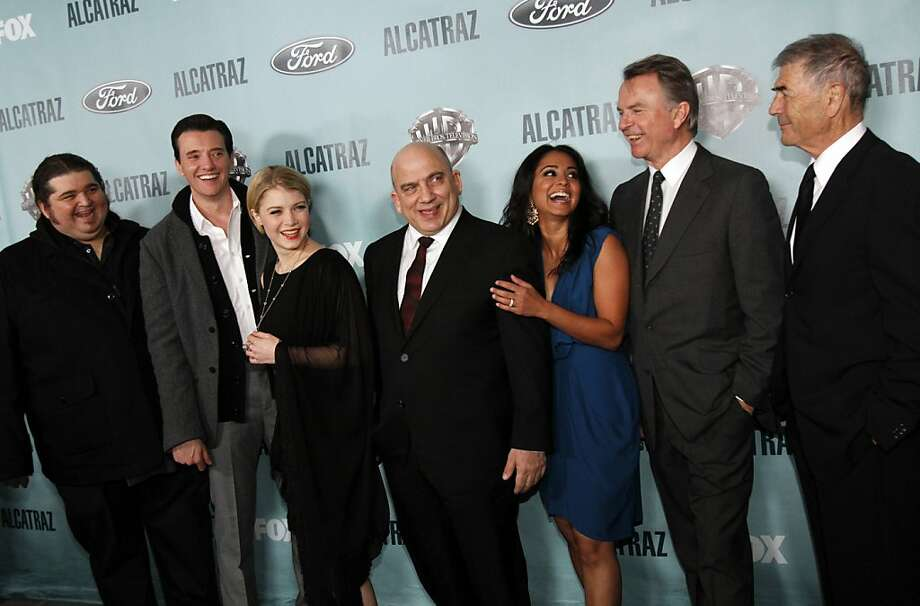 Stars of the new Fox show Alcatraz attend the premiere party on Alcatraz Island in San Francisco, Calif., Wednesday, January 11, 2012.  From left, Jorge Garcia, Jason Butler Harner, Sarah Jones, Jonny Coyne, Parminder Nagra, Sam Neill, and Robert Forster. Photo: Sarah Rice, Special To The Chronicle