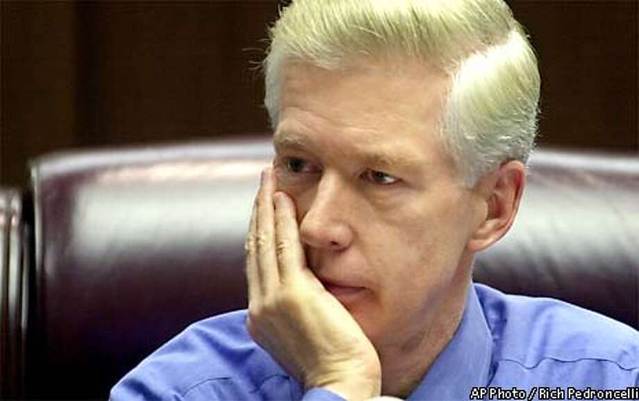 ** ADVANCE FOR SUNDAY, JAN. 5 ** California Gov. Gray Davis listens to questions during a round-table session with reporters at his Capitol office in Sacramento, Calif., Dec. 19, 2002. Davis, who will be sworn-in for a second term Monday, Jan. 6, 2003, starts his new term facing a $35 billion budget shortfall. (AP Photo/Rich Pedroncelli) Photo: RICH PEDRONCELLI