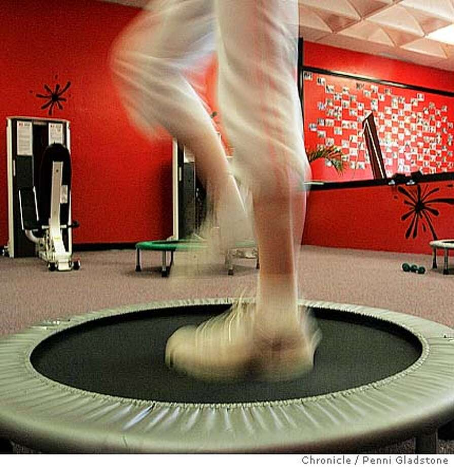 NBFITWIZE08  Megan Ophir age 15, works out on this trampolene.  Note at right are pictures of kids on the wall who belong to this fitness center.  Warren Gendel, a former bodybuilder, has opened Fitwise4kids,� a franchise of gymnasiums to encourage kids 6-14 to get fit and learn better nutritional habits. The first gym opened in February in Novato and was recently franchised. Photo by staff photographer Penni Gladstone  San Francisco Chronicle Photo: Penni Gladstone
