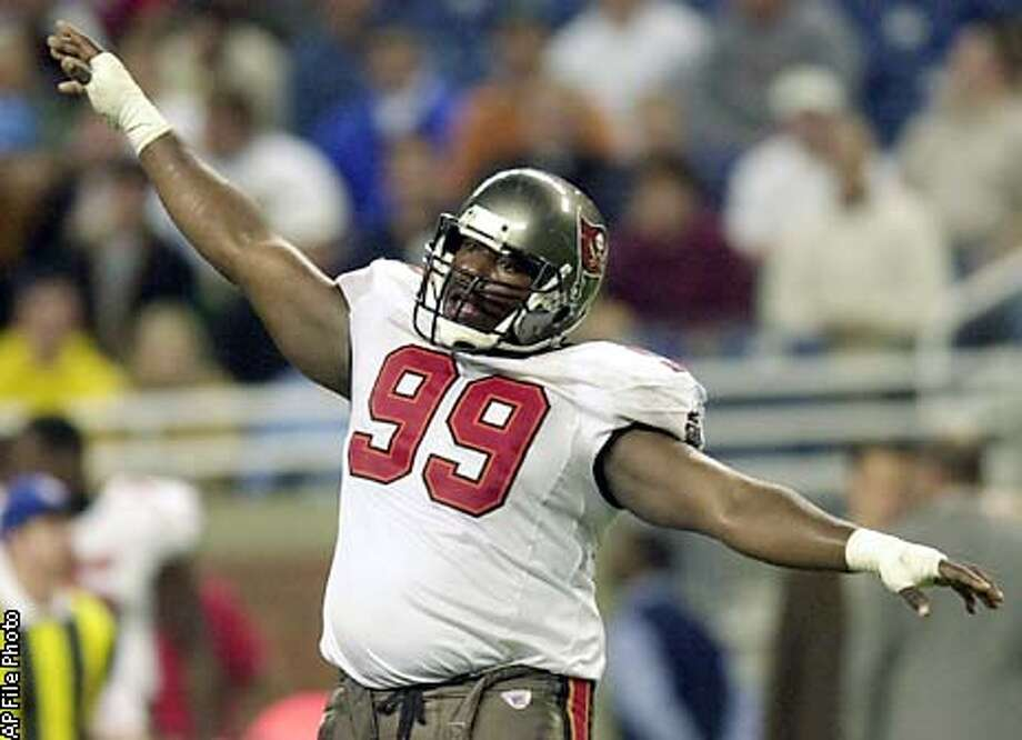 ** ADVANCE FOR WEEKEND EDITIONS JAN. 4 -5 ** Tampa Bay Buccaneers defensive tackle Warren Sapp celebrates after Detroit Lions kicker Jason Hanson missed a 57-yard field goal that would have tied the game late in the fourth quarter Sunday, Dec. 15, 2002, in Detroit. It cost Tampa Bay a bundle to acquire Jon Gruden, and the team is already getting a return on its investment. The Buccaneers not only won the NFC South in their first season under the NFL's youngest coach, but also set a franchise record forvictories and shared the league's best record. (AP Photo/Paul Sancya) Photo: PAUL SANCYA