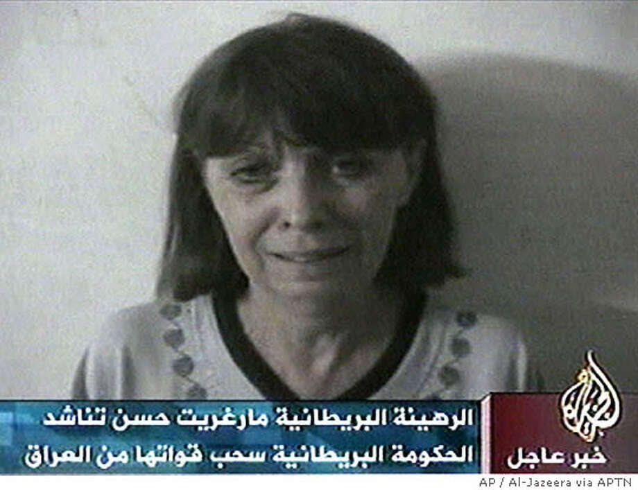 "Margaret Hassan, the kidnapped director of CARE International in Iraq, appears in this image made from television in a videotape aired by the Arabic television station Al-Jazeera, Friday, Oct. 22, 2004. Hassan is seen weeping and pleading with British Prime Minister Tony Blair to withdraw troops from Iraq ""and not bring them to Baghdad"" because ""this might be my last hours."" ""Please help me. Please help me,"" said a terrified Hassan, breaking down in tears and burying her face in a tissue. She said she might be killed like British hostage Kenneth Bigley, who was beheaded by his captors earlier this month. (AP Photo/Al-Jazzera via APTN) ** TV OUT ** Photo: AL JAZEERA"