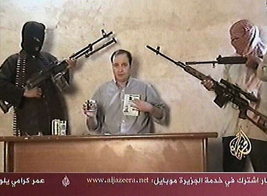 This TV image taken from footage broadcast by the Al Jazeera satellite channel on Wednesday April 13, 2005 which it says shows an American who had been kidnapped in Iraq two days before. The US embassy said the man on the video appeared to be the same American contract worker kidnapped from the Baghdad area on Sunday. A spokesman for the embassy said the man's name was Jeffrey Ake, but gave no further details. No group has claimed responsibility for the abduction. (AP Photo/Al Jazeera via APTN) ** TV OUT **