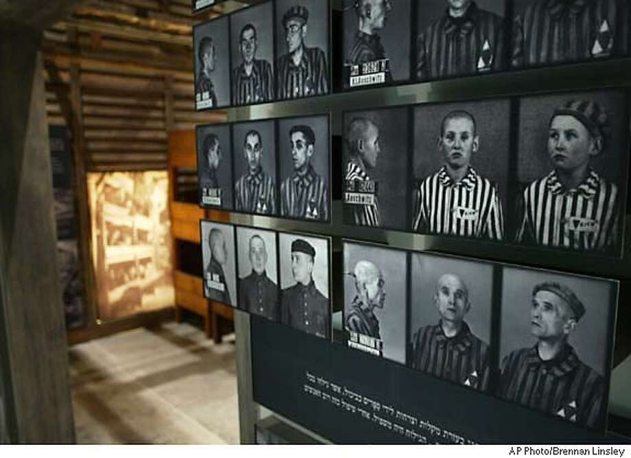 Official registration photos of inmates of Auschwitz, the Nazi concentration camp, are part of an exhibit inside the new Holocaust History Museum, which is to be inaugurated March 15, at Yad Vashem Holocaust Memorial, in Jerusalem, Friday, March 11, 2005. Yad Vashem officials say the new museum is the culmination of ten years of redevelopment work at the memorial. (AP Photo/Brennan Linsley) Photo: BRENNAN LINSLEY