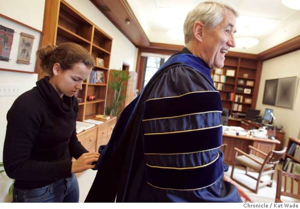 REGALIA_044_KW.jpg On 3/29/05 in Berkeley (L to R) Laurel Beck, a student assistant in the chancellor's office helps Robert Birgeneau, Phd., the new chancellor of UC Berekely tries on he academic robes that date back to the medieval era including his yale hood that represents his Phd. and the UC Berkeley robe with three royal blue velvet stripes representing his doctorate in his office at California Hall on the UC campus. Birgeneau will be inaugurated April 15th. Kat Wade/ The Chronicle MANDATORY CREDIT FOR PHOTOG AND SF CHRONICLE/ -MAGS OUT