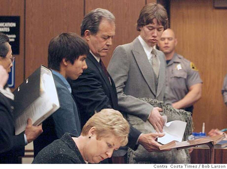 Left to right are Nicholas Sigmon, Collins attorney and Paul Collins stand before Judge Robert Fairwell in Hayward Hall of Justice in Hayward Calif., Wednesday April 13th, 2005. Both Collins and Sigmon changed their plea to no contest for taking Sigmon's pet rabbit and duct taping and throwing the rabbit into Lake Don Castro with a powerful firecracker. (BOB LARSON/CONTRA COSTA TIMES) Photo: BOB LARSON