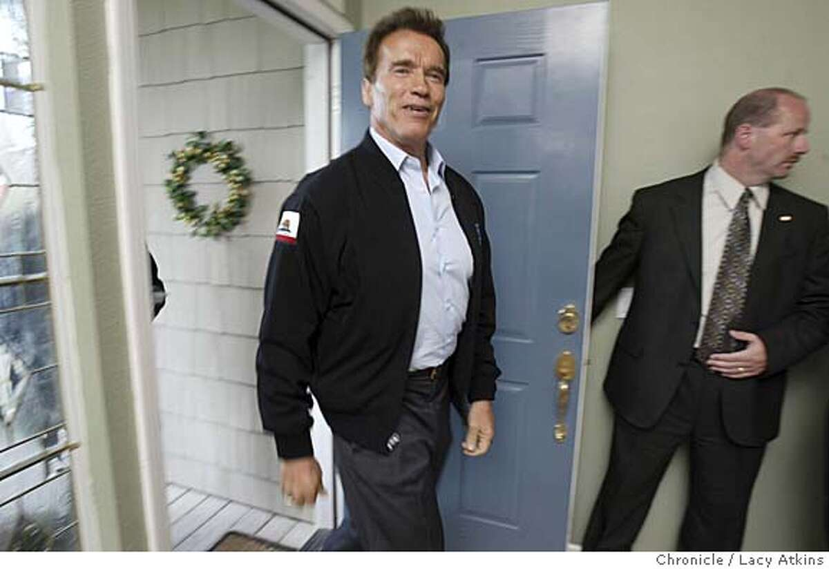 Governor Arnold Schwarzenegger walks into the home of Nancy Miller in Santa Rosa for his kitchen cabinet meeting, April 7, 2005. will give a press conference at 3 p.m. in Santa Rosa at the Hyatt Vineyard Creek, 170 Railroad Avenue. As pool photo and reporter, we will then be driven in motorcade over to the site of the