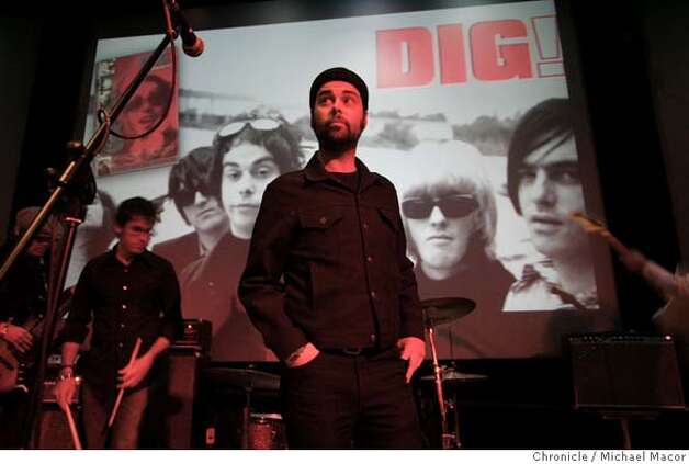 "dig006_mac.jpg Gion, in front of the cover shot of himself and band, ""Brian Jonestown Massacre"". for the film, ""DIG"" during a sound check with his present band, ""The Diletantes"".Tambourine player and San Francisco native Joel Gion is on of the most endearing characters in ""DIG!,"" the documentary chronicling the career trajectories of rock acts the Dandy Warhols and the Brian Jonestown Massacre. On Tuesday, the film will get a DVD release -- Gion hosts a screening at the Metreon Action Theater, plays with his new band and signs copies. We hang out with him. 4/12/05 San Francisco, Ca Michael Macor / San Francisco Chronicle Mandatory Credit for Photographer and San Francisco Chronicle/ - Magazine Out Photo: Michael Macor"