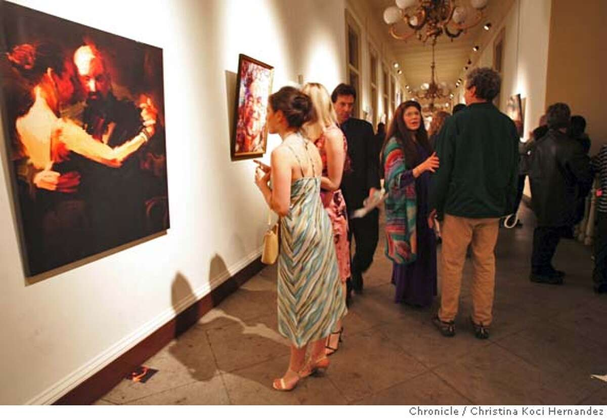 Guests look at a piece called,