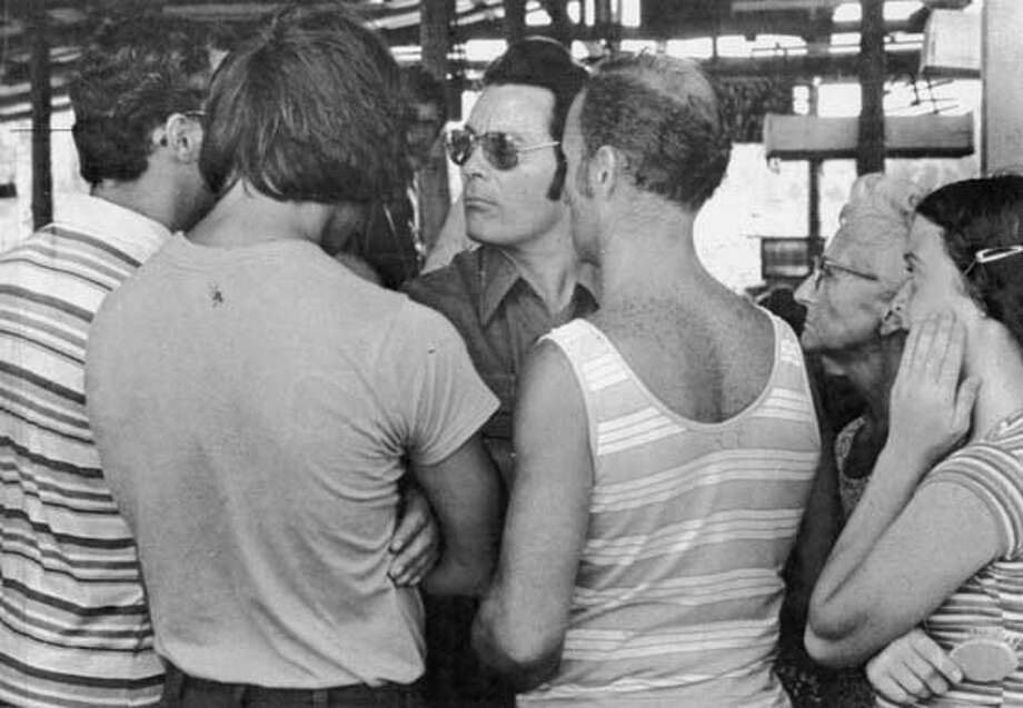 TIMELINE23O/B/01FEB79/SC/SAN FRANCISCO EXAMINER VIA UPI  JIM JONES WITH THE PARKS FAMILY, GERALD AND DALE AS THEY TELL HIM THEY WANT TO LEAVE WITH LEO RYAN FROM JONESTOWN, GUYANA