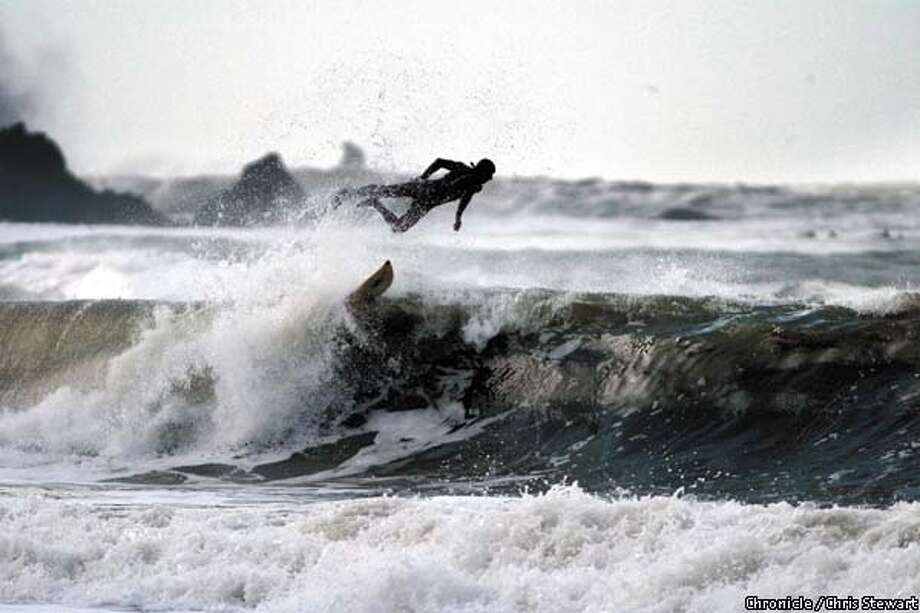 A surfer makes an aerial dismount at Lands End. BY CHRIS STEWART/THE CHRONICLE Photo: CHRIS STEWART