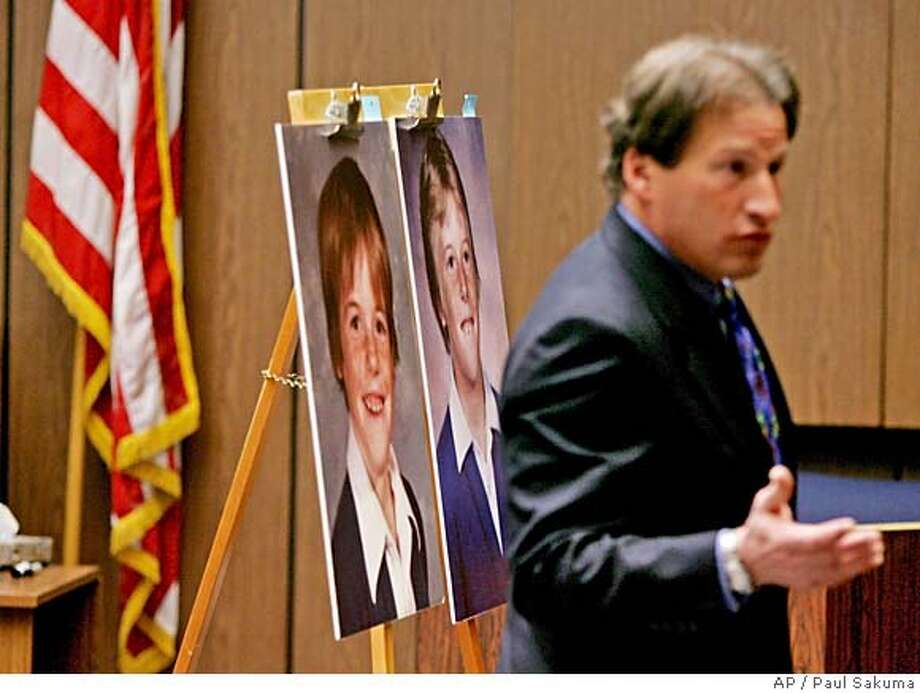 Attorney Rick Simons, right, talks to the jury as he stands in front of childhood photos of his clients Bob Thatcher, right, and his brother, Tom Thatcher, left, during, closing arguments in a Hayward, Calif., courtroom, Tuesday, April 12, 2005, in a civil case brought against the Catholic Diocese of Oakland by the two brothers who allege they were molested by a priest. (AP Photo/Paul Sakuma) Photo: PAUL SAKUMA