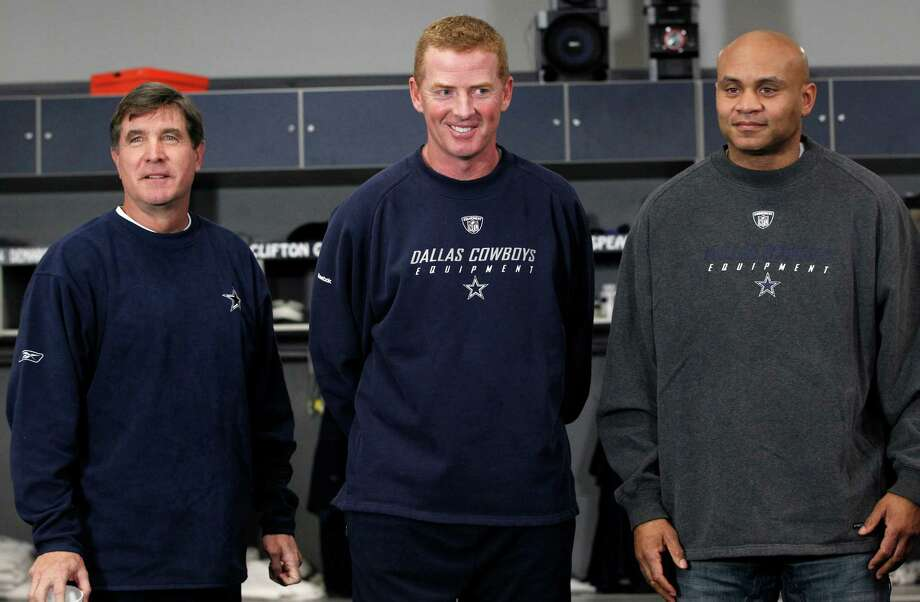 Dallas Cowboys head coach Jason Garrett, center, stands for a photo with new assistant football coaches Bill Callahan, left, and Jerome Henderson after a media availability at the team's headquarters in Irving, Texas, Thursday, Jan. 19, 2012. Callahan will serve as offensive coordinator/offensive line coach and Henderson will be the secondary coach. Photo: LM Otero, AP / AP