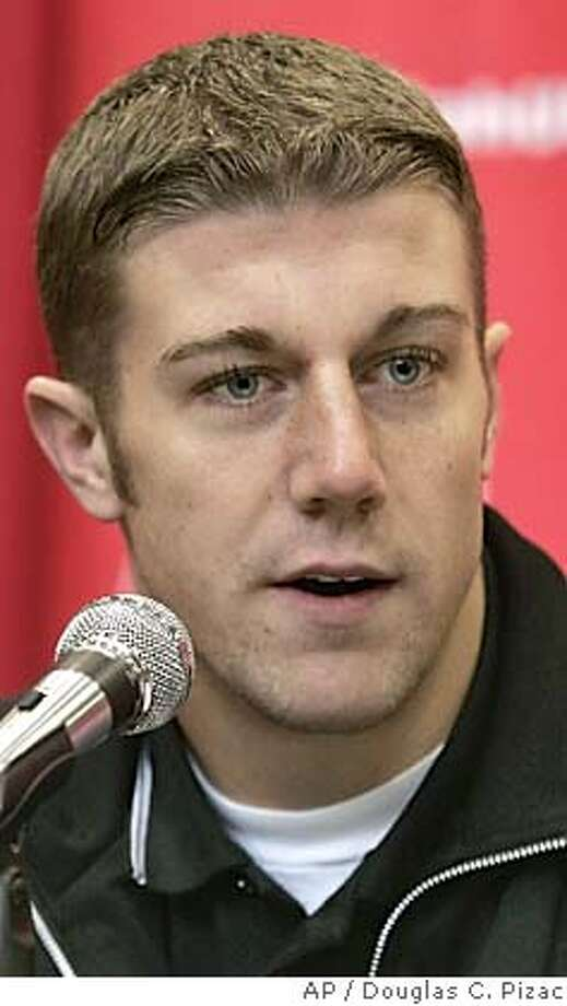** FILE ** Utah quarterback Alex Smith answers questions during a news conference in Salt Lake City. in this Jan. 4, 2005 photo. (AP Photo/Douglas C. Pizac) Photo: DOUGLAS C. PIZAC