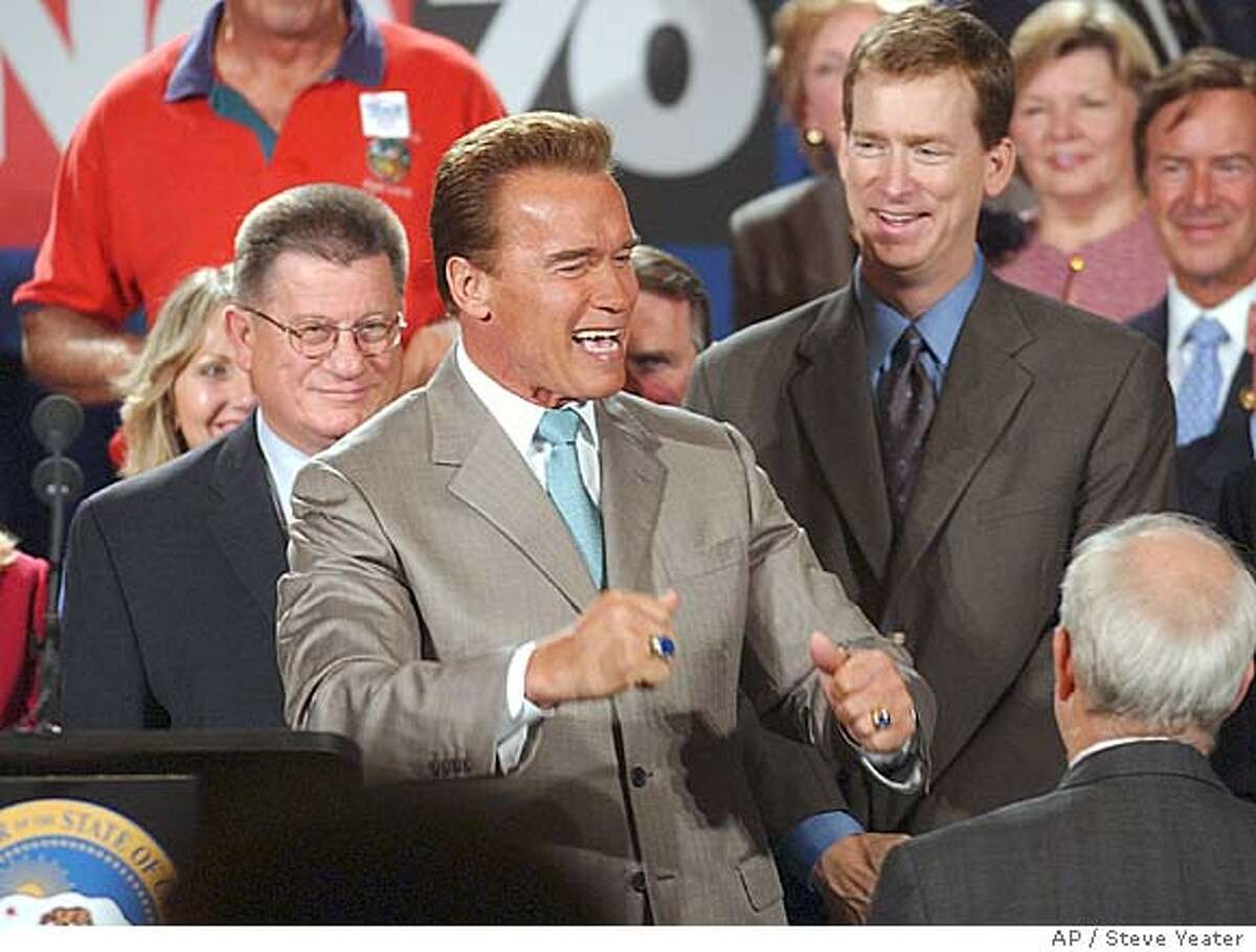 California Governor Arnold Schwarzenegger jokes with supporters after a news conference calling for oposition to Indian gaming Propositions 68 and 70 in Sacramento, Calif., on Tuesday, Oct. 19, 2004.(AP Photo/Steve Yeater)
