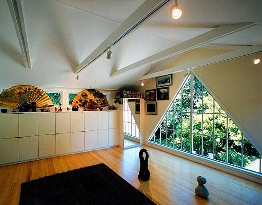 A sleek art studio was created atop a garage in the Berkeley Hills. The triangular window lets in light and views toward Tilden Park. on 10/6/04 in . / HO
