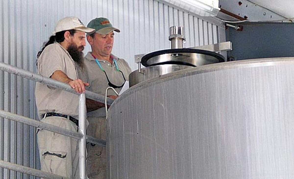 Ernest Weir and the rabbi, David Miller are looking over a fermentation tank at Hagafen Cellars