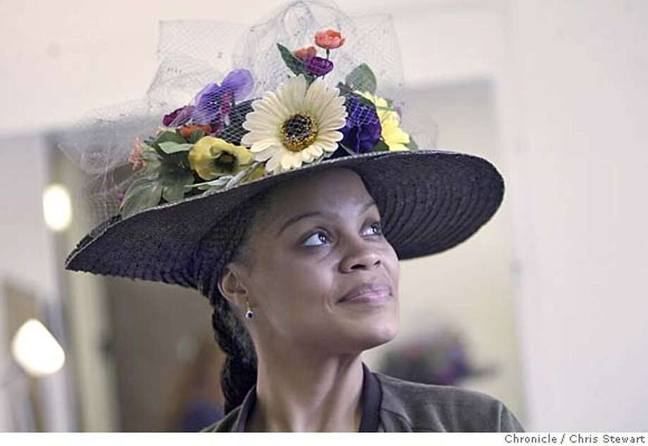 hats09067.jpg Event on 3/29/05 in Mountain View.  Actress Tiffany Thompson stars in Theaterworks production of Crowns, a play about Hats. She tries on a flower-bedecked hat by Natasha Lewis - one of the different hats she will wear in the production at the Mountain View theater. Chris Stewart / The Chronicle MANDATORY CREDIT FOR PHOTOG AND SF CHRONICLE/ -MAGS OUT Photo: Chris Stewart