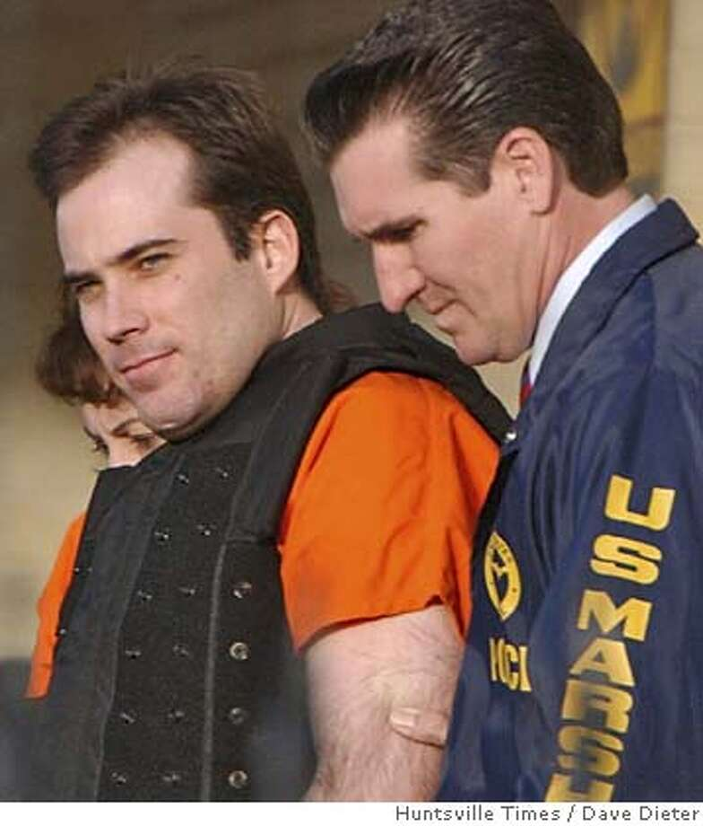 ** FILE * Eric Rudolph is led from federal courthouse in Huntsville, Ala., March 29, 2005, following a court appearance. Rudolph has agreed to plead guilty to the 1996 bombing at the Atlanta Olympics and three other blasts, a source close to the case told The Associated Press on Friday, April 8, 2005. (AP Photo/Huntsville Times, Dave Dieter) Photo: DAVE DIETER