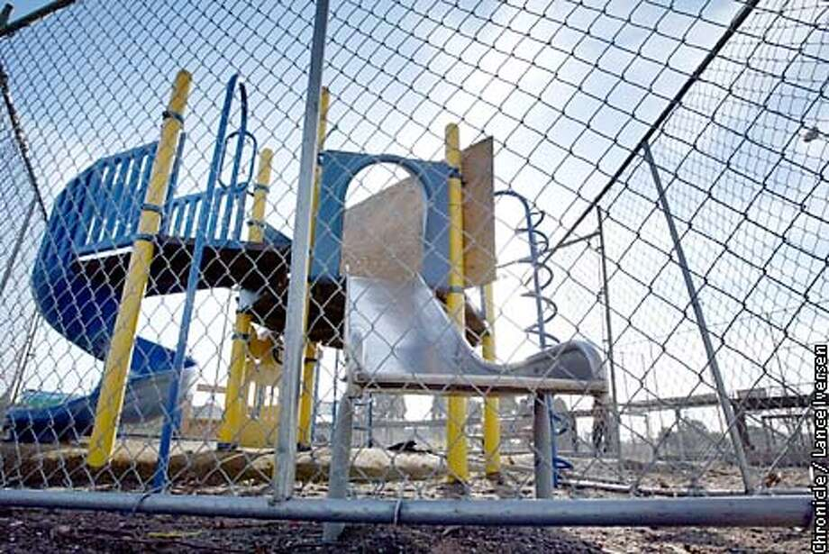 damaged play ground equipment is fenced off at 1075 62nd street in Oakland. By LANCE IVERSEN/SAN FRANCISCO CHRONICLE Photo: LANCE IVERSEN