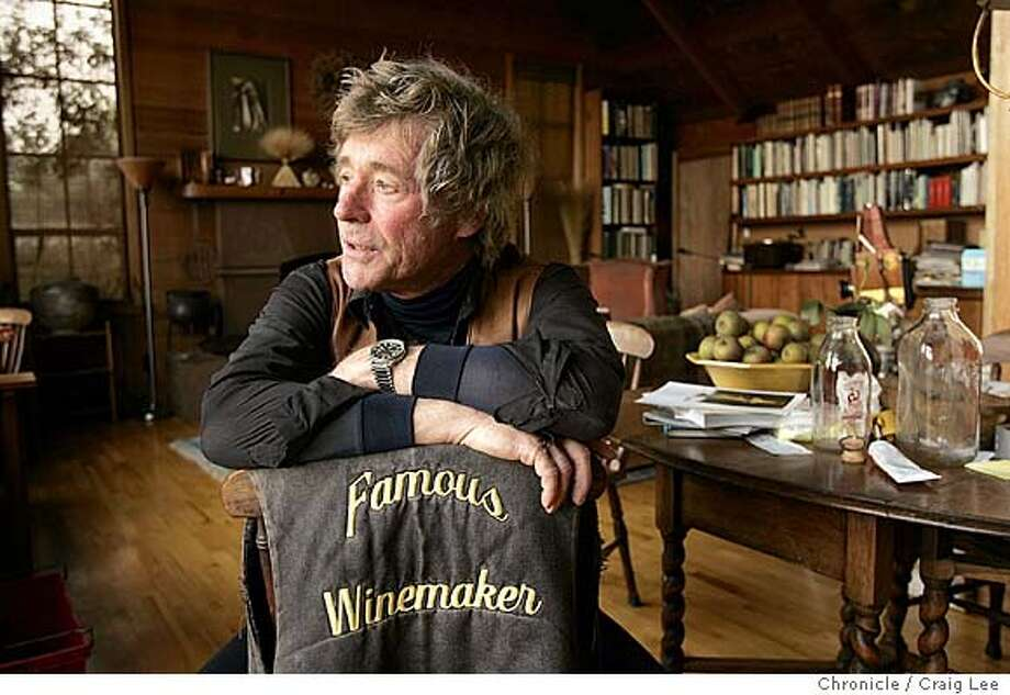 "Wine story profile on Sean Thackrey, who used to own an art gallery in San Francisco andis now a small, idiosyncratic and succesful winemaker working way off the beaten path at his home in Bolinas. Photo of Sean Thackrey with his ""Famous Winemaker"" jacket, inside his home.  Event on 10/14/04 in Yountville. Craig Lee / The Chronicle Photo: Craig Lee"