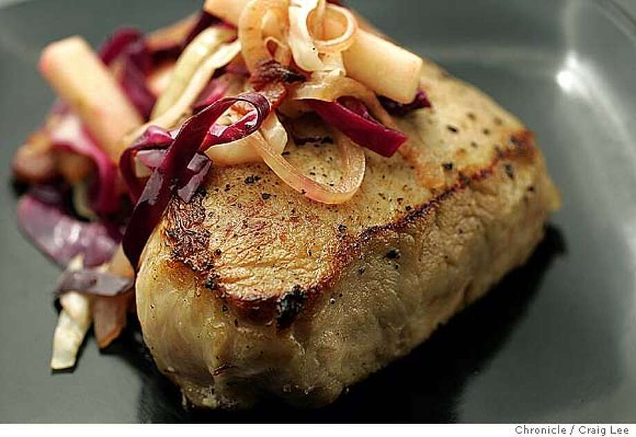 Seasonal story on heirloom apple varieties grown in Sebastopol. Photo of pork chops with apples. Food photo styled by Caroline Pagel.  Event on 10/9/04 in San Francisco. Craig Lee / The Chronicle MANDATORY CREDIT FOR PHOTOG AND SF CHRONICLE/ -MAGS OUT Food#Food#Chronicle#10/20/2004##Advance##0422402216 Photo: Craig Lee