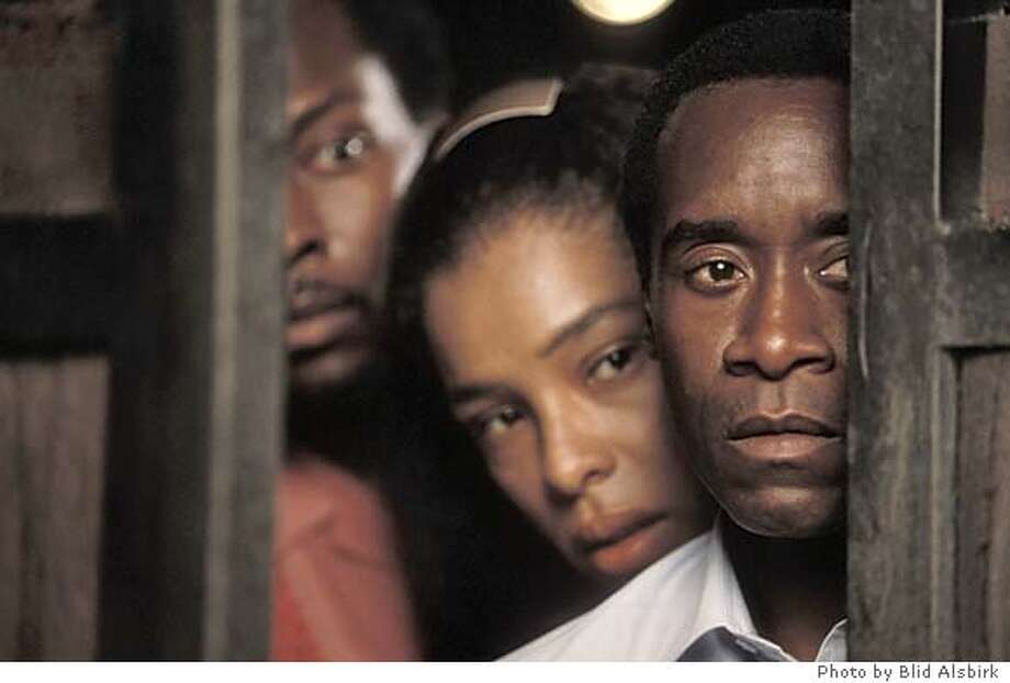 M-33 Thomas (ANTONIO LLYONS), Tatiana (SOPHIE OKONEDO) and Paul (DON CHEADLE) in United Artists' HOTEL RWANDA. Photo by Blid Alsbirk Ran on: 09-26-2004  Knut Berger and Lior Ashkenazi near the Red Sea in Eytan Fox's &quo;Walk on Water.&quo; Ran on: 10-24-2004  Don Cheadle: keeping a low profile a as character actor. Datebook#Datebook#Chronicle#11/15/2004#ALL#Advance##0422365786