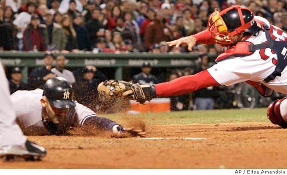 New York Yankees' Miguel Cairo touches homeplate barely ahead of the tag by Bosotn Red Sox catcher Jason Varitek in the sixthi inning of game 5 of the ALCS Monday, Oct. 18 2004 in Boston. Cairo score on teammate Derek Jeter's three-run double off Sox's Pedro Martinez. (AP Photo/Elise Amendola) Photo: ELISE AMENDOLA