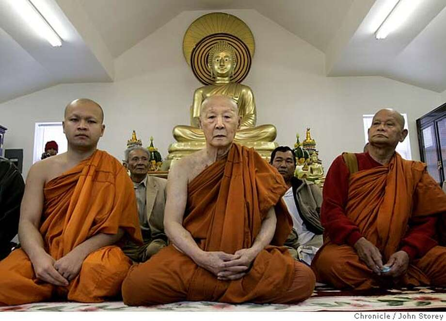 Cambodia_jrs_0056_jpg.JPG  Left to Right: Som Vantha, abbot Sam Son and Dam Paul in the temple. The Oakland Buddhist Temple in chaos. The board of directors signed over control to a Massachusetts corporation and the community feels it should be under their control.  John Storey Oakland Event on 3/25/05 MANDATORY CREDIT FOR PHOTOG AND SF CHRONICLE/ -MAGS OUT Photo: John Storey