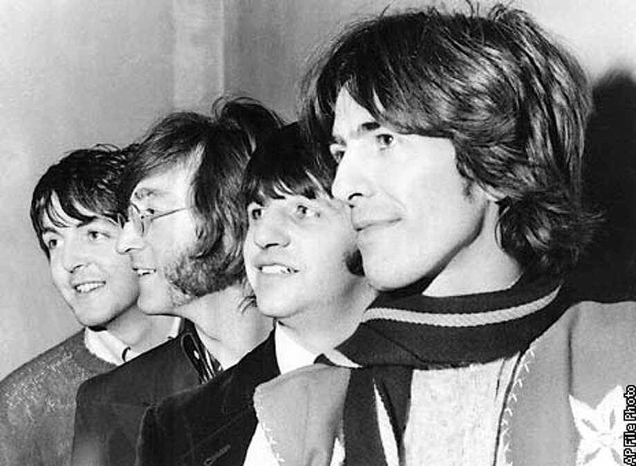 The Beatles pose together on Feb. 28, 1968 in an unknown location. From left are Paul McCartney, John Lennon, Ringo Starr and George Harrison. Police appear to have recovered about 500 original Beatles tapes that were stolen in the 1970s, including some never-released tracks, during raids Friday on members of a piracy racket in England and the Netherlands. British police said the tapes were ``priceless.'' (AP Photo)