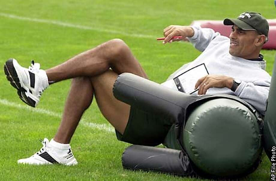 ** FILE **New York Jets head coach Herman Edwards watches his players during training camp at Mitchell Field in Hempstead, N.Y., Wed. Aug. 28, 2002. On some NFL teams, coaches bark and players strut. Egos clash like cymbals. A sack is cause for a dance. A touchdown is time for an autograph show. Edwards is not of that world.(AP Photo/Ed Betz) Photo: ED BETZ