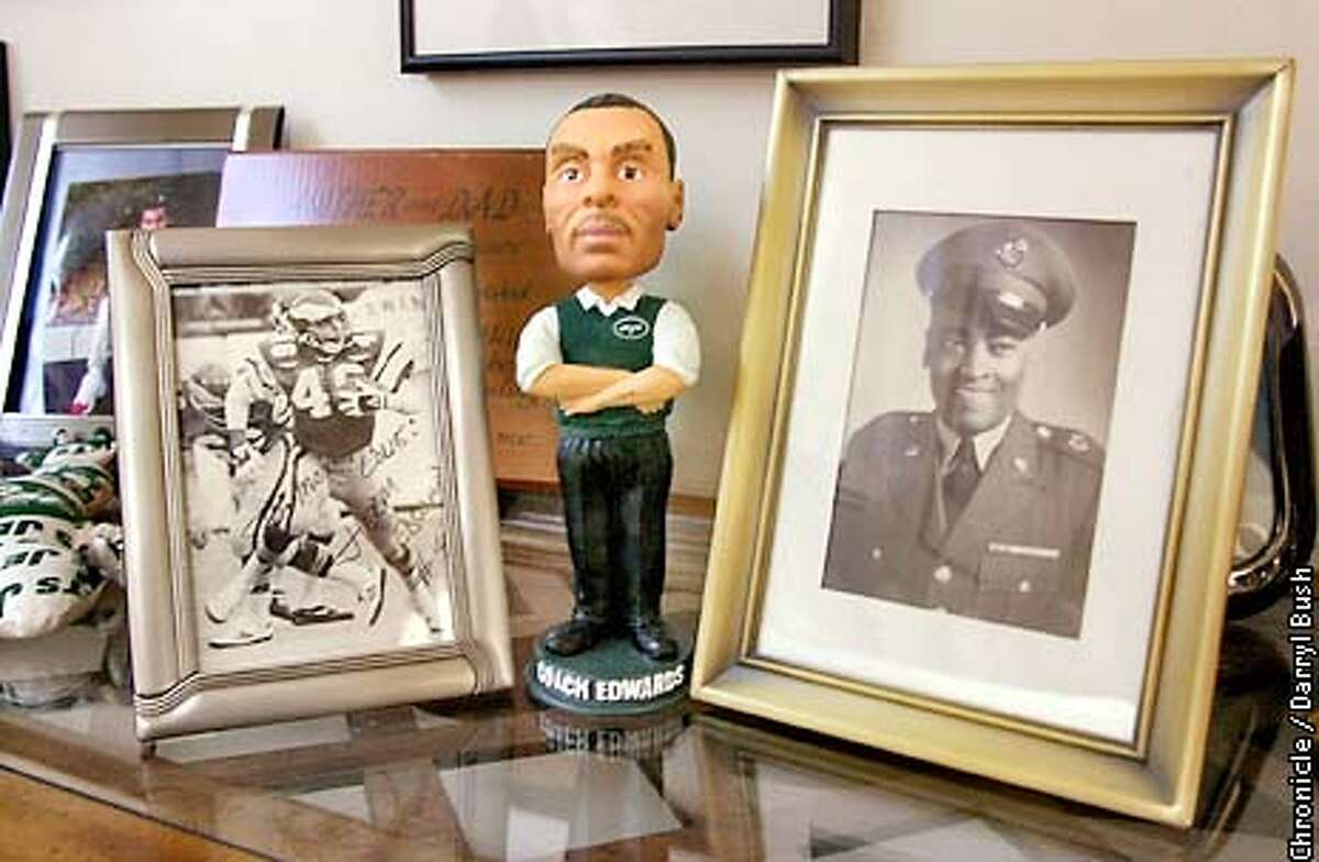 Martha Edwards mom of New York Jets coach, Herman Edwards, table has pictures on it of her son as a Philidephia Eagle, left, a bobblehead doll of New York Jets Coach Edwards (her son now), center, and an early photo of Herman Edwards Sr. as a Master Sgt. in the US Army, in her Seaside home. CHRONICLE PHOTO BY DARRYL BUSH