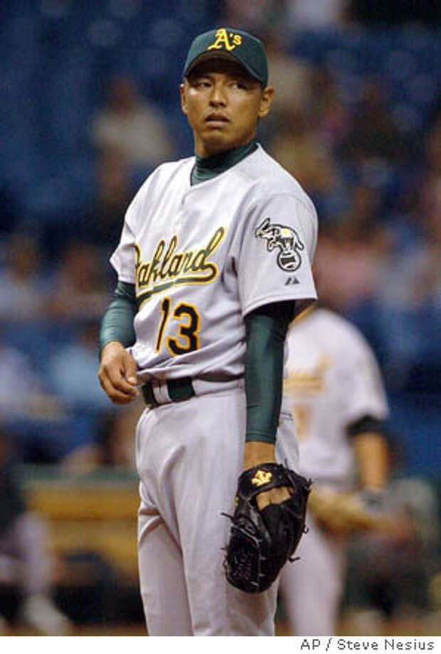 Oakland Athletics pitcher Keiichi Yabu of Japan looks toward first base in his major league debut after relieving starter Barry Zito against the Tampa Bay Devil Rays during the fourth inning Saturday, April 9, 2005 at Tropicana Field in St. Petersburg, Fla. Tampa Bay pounded Oakland 11-2. (AP Photo/Steve Nesius) Photo: STEVE NESIUS