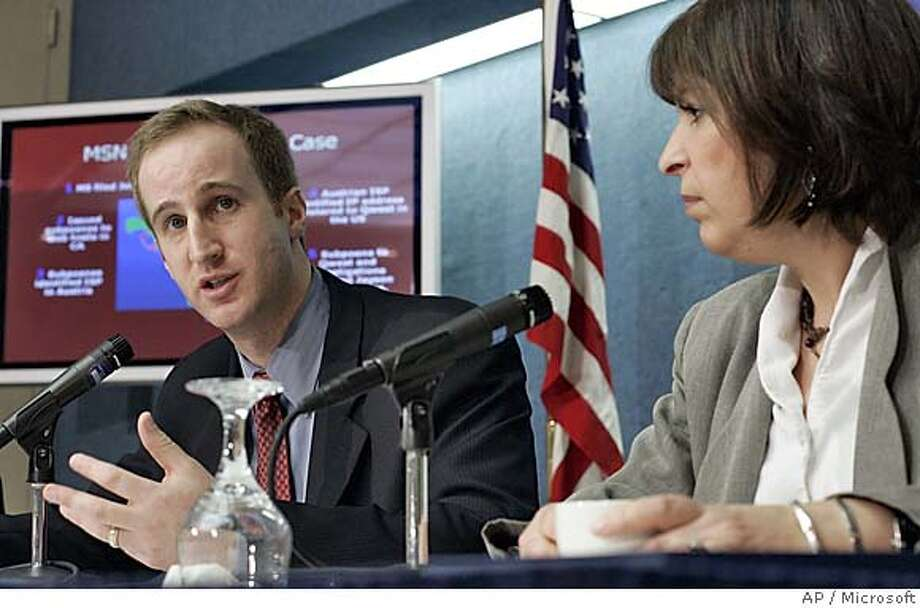 "In a photo released by Microsoft, Lydia Parnes, right, Director of the Bureau of Consumer Protection at the Federal Trade Commission, listens as Aaron Kornblum, Microsoft Internet Safety Enforcement attorney, announces 117 lawsuits against ""phishers"", criminals actively attempting to steal identities and personal information from consumers, at a news conference in Washington Thursday, Mach 31, 2005. (AP Photo / Stephen Chernin/Microsoft) MICROSOFT HANDOUT"