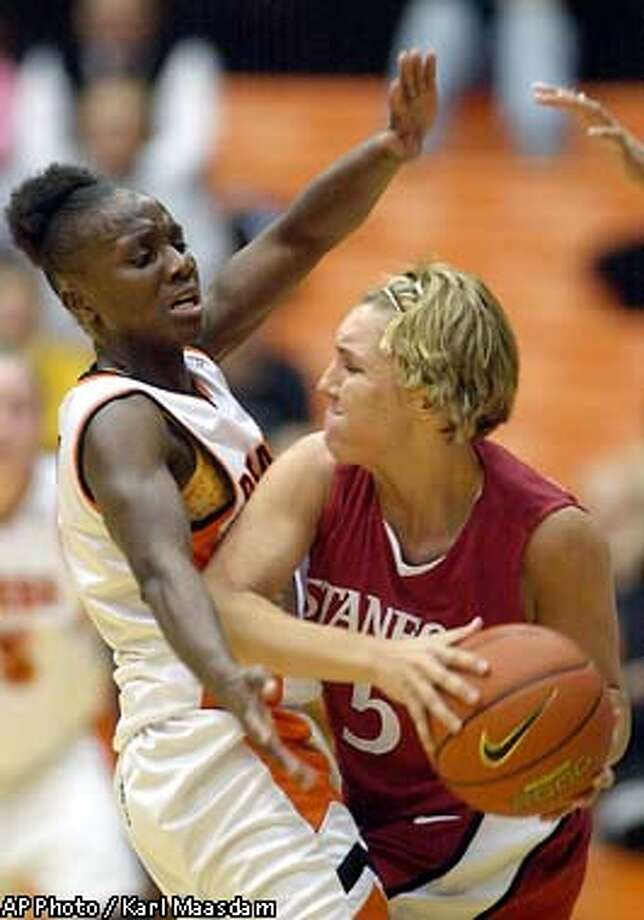 Stanford's Kelley Suminski, right, tries to get around Oregon State's Juleen Smith durring the first half of their Pac-10 game Thursday Jan. 9 2003 at Gill Coliseum in Corvallis, Ore. (AP Photo/Karl Maasdam) Photo: KARL MAASDAM