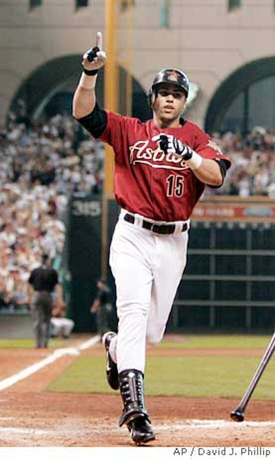 Houston Astros' Carlos Beltran celebrates his solo home run in the seveth inning against the St. Louis Cardinals in Game 4 of the National League Championship Series in Houston, Sunday, Oct. 17, 2004. (AP Photo/David J. Phillip) Photo: DAVID J. PHILLIP
