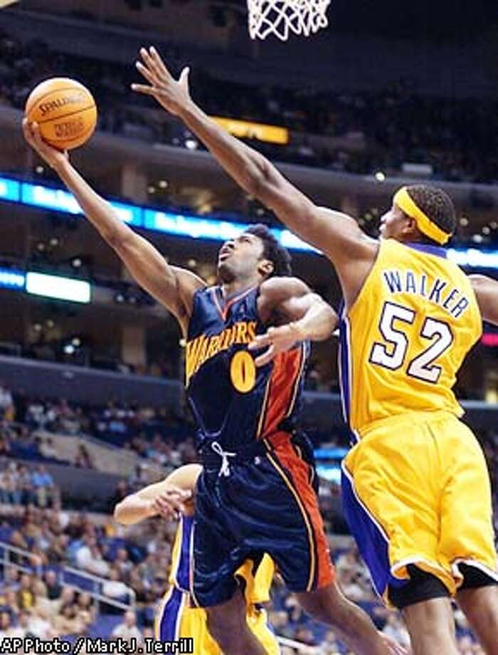 Golden State Warriors' Gilbert Arenas, left, goes up for a shot as Los Angeles Lakers' Samaki Walker guards during the first half Friday night, Nov. 15, 2002, in Los Angeles. (AP Photo/Mark J. Terrill) Photo: MARK J. TERRILL
