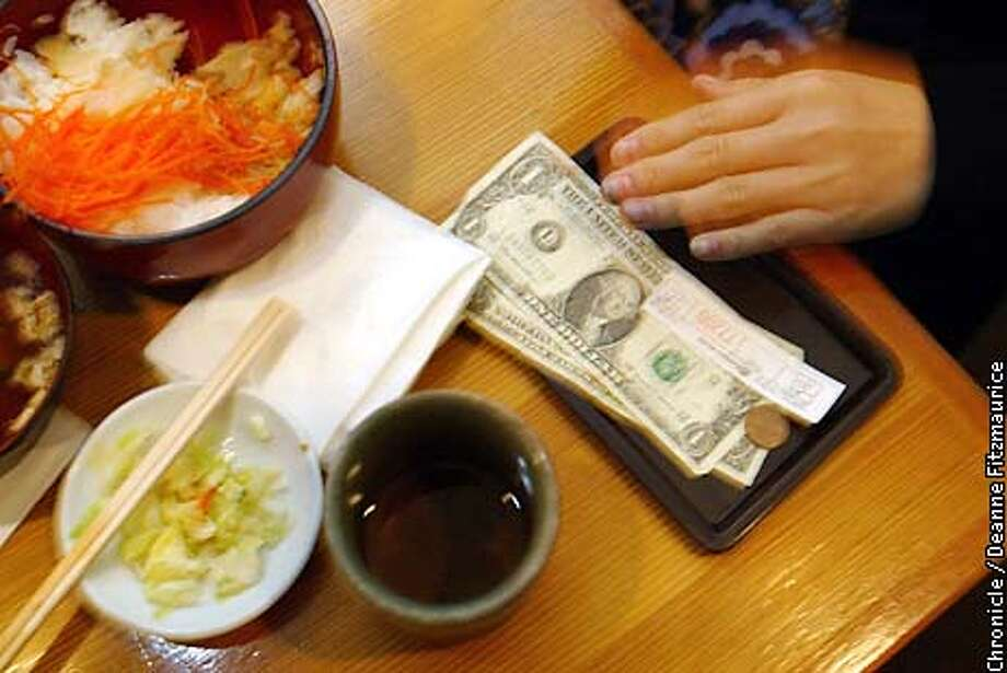 """Governor Gray Davis' proposed budget will contain a one cent sales tax increase to help cover costs of health and social programs. Rosanna Chu pays for her lunch at Kantaro sushi. she said that she will continue to eat out even with a sales tax increase because she said """"people have to eat"""". CHRONICLE PHOTO BY DEANNE FITZMAURICE Photo: Deanne Fitzmaurice"""