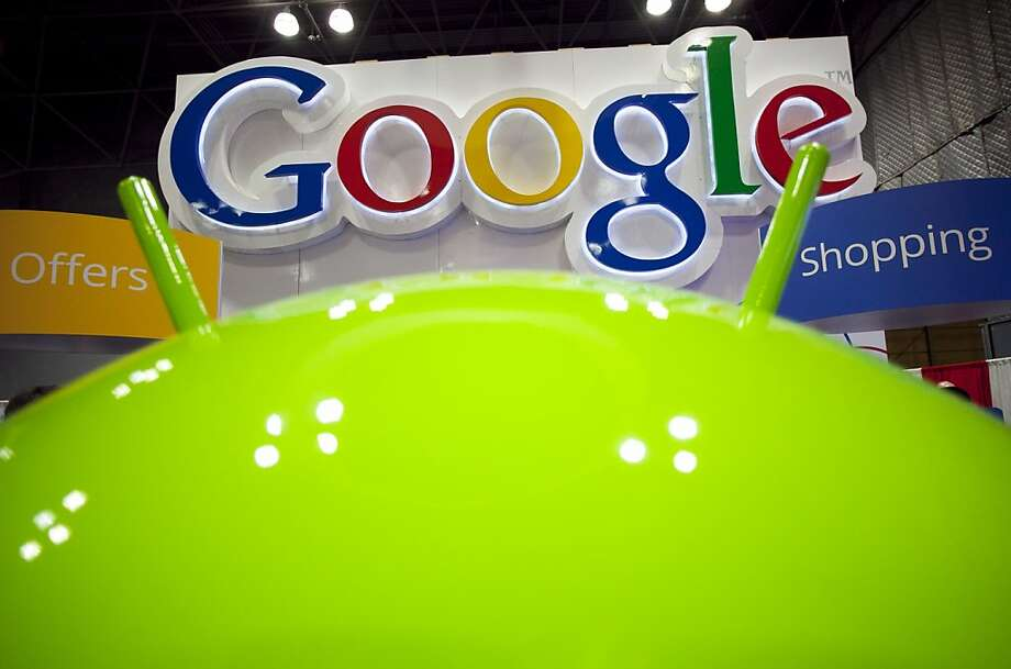 In this Jan. 17, 2012 photo, a sign for Google is displayed behind the Google android robot, at the National Retail Federation, in New York. Google Inc., releases quarterly financial results Thursday, Jan. 19, 2012, after the market close. (AP Photo/Mark Lennihan) Photo: Mark Lennihan, Associated Press