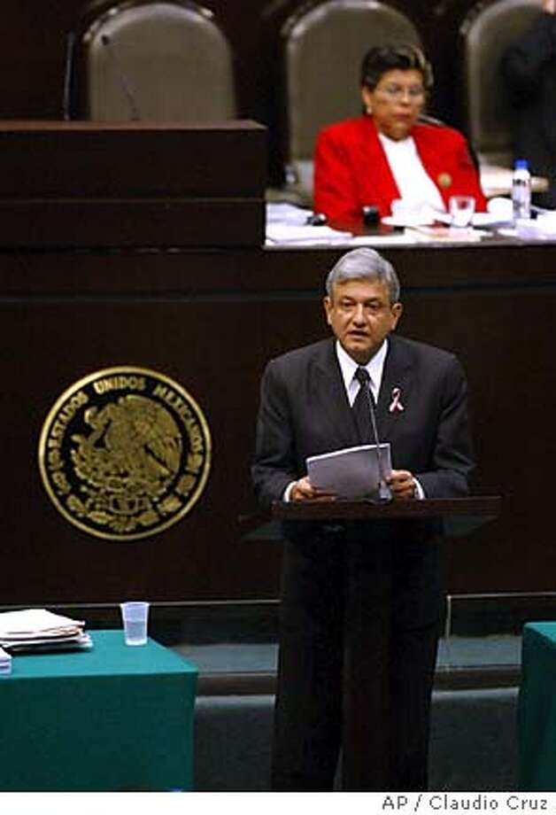 Mexico City Mayor Andres Manuel Lopez Obrador addresses the National Congress in Mexico City , Mexico, on Thursday April 7, 2005. Early Thursday, Lopez Obrador formally declared his intention to run for president next year even as Congress was to decide whether he should face criminal charges for allegedly disobeying a court order in a land-use case--a decision that could knock him out of the race. (AP Photo/ Claudio Cruz)** EFE OUT** Photo: CLAUDIO CRUZ