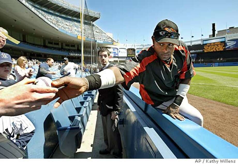 Baltimore Orioles outfielder Sammy Sosa signs autographs for fans before the start of the Orioles game against the New York Yankees, Saturday, April 9, 2005, at Yankee Stadium in New York. (AP Photo/Kathy Willens) Photo: KATHY WILLENS
