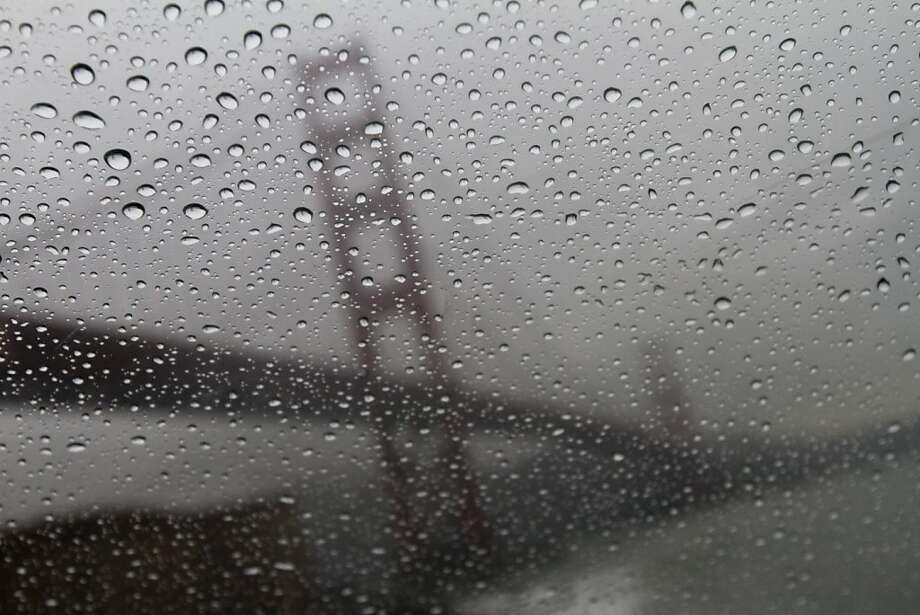 Rain gathers on a windshield near the Golden Gate Bridge during a rainfall on Thursday afternoon. Photo: Douglas Zimmerman, Special To The SF Gate