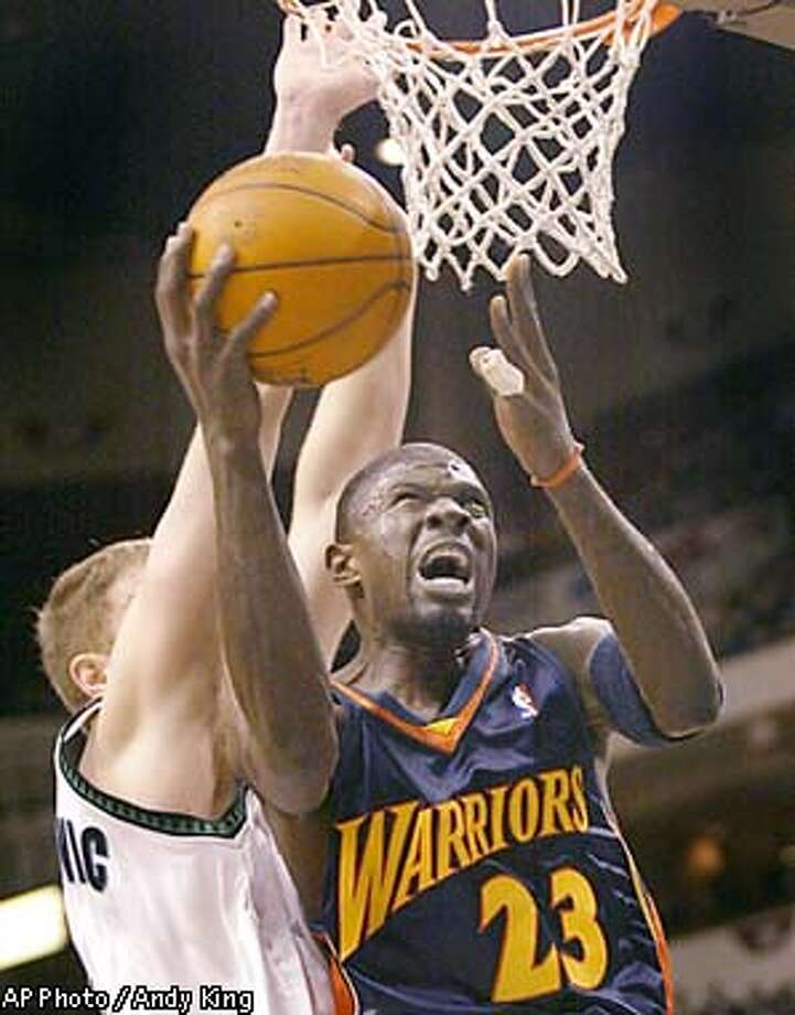 Golden State Warriors Jason Richardson (23) shoots as Minnesota Timberwolves Rasho Nesterovic defends in the first quarter at the Target Center in Minneapolis, Wednesday, Jan. 8, 2003. (AP Photo/Andy King) Photo: ANDY KING