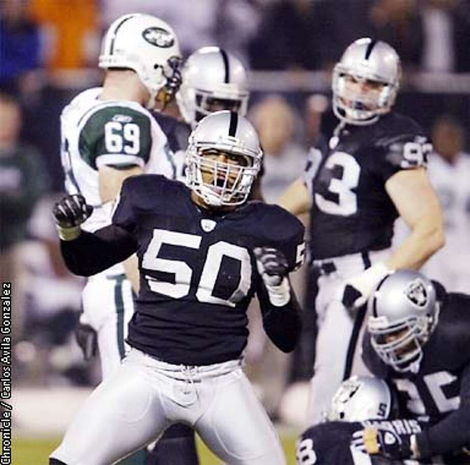 Eric Barton, celebrates a first quarter run stop early in the Jets first possession. The Oakland Raiders played the New York Jets at Network Associates Coliseum in Oakland, Ca., on December 2, 2002.  (PHOTO BY CARLOS AVILA GONZALEZ/THE SAN FRANCISCO CHRONICLE) Photo: CARLOS AVILA GONZALEZ