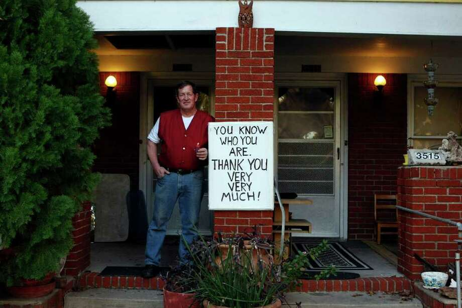 """Doug Dreher created a sign to thank unknown good Samaritans who alerted him of a fire on the front porch of his duplex on Michaux Street last month. They doused the fire, he said, """"and then they were just gone."""" Photo: Johnny Hanson / © 2012  Houston Chronicle"""